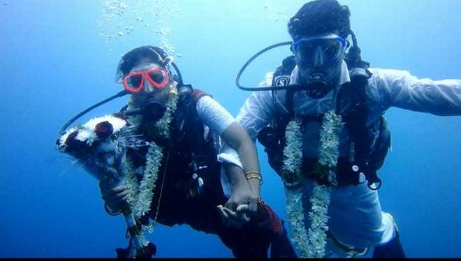 Taking the plunge: Indian couple ties knot underwater